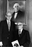President Stanger and President Emeritus McPheeters in front of portrait of H C Morrison, Dec 1976
