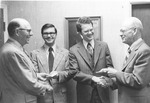 Dennis Kinlaw and Frank Stanger present checks for World Hunger Fund, April 1977