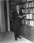 Frank Stanger in front of book case