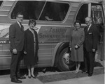 David and Elisabeth Edward and Frank and Mardelle Stanger in front of the Singing  Seminarians bus, March 1966