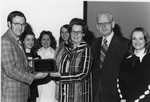 Mardelle Stanger receiving a plaque in her honor, Spring, 1977