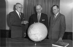 Frank Stanger with WC Mavis and WE Savage looking at a globe