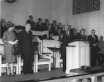 J. C. McPheeters at Chapel addressing an unidentified couple