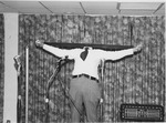J. C. McPheeters demonstrating the Exer-Genie at the Development Association for Christian Institutions (DACI) meeting, 1979 8of8