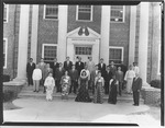 J.C. McPheeters with international group in front of Asbury's Adminstration Building