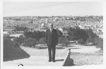 J. C. McPheeters standing with Jerusalem (or some eastern city) in background