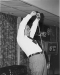 J. C. McPheeters demonstrating the Exer-Genie at the Development Association for Christian Institutions (DACI) meeting, 1979 5of8