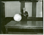 J. C. McPheeters yearbook portrait with Bible and globe, 1961