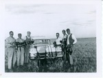 J. C. McPheeters with 5 others posing with their pheasants