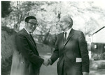 J.C McPheeters shaking hands with an Asian man