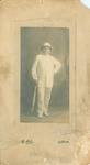 H.C. Morrison wearing a white suit