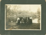 H.C. Morrison in a group photo in front of a lake
