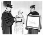 Frank Stanger presenting Gaile Morris with the Distinguished Service Award, May 1974