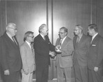 Frank Stanger presenting Harold Kuhn with a  watch for 25 years of service, May 1972