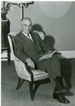J. C. McPheeters seated in a chair