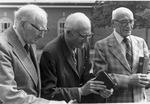 J. C. McPheeters praying with 2 other men