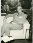 J. C. McPheeters seated on a chair