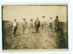 H.C. Morrison at Asbury College Farm posing for photo with workers