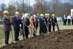 Kalas Village Groundbreaking:  Group digging with shovels