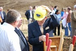 Kalas Village Groundbreaking:  Tennent and unidentified man with shovel