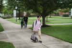 An International Student Walking Behind Estes Chapel