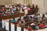Students and Faculty Listening in Estes Chapel - Wider Shot