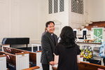 Rev. Nam Koh and Suzie Patrick Talking in Estes Chapel