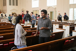 International Students Talking in Estes Chapel