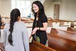 Suzie Patrick Talking with an International Student in Estes Chapel