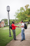 Two Male Students Shaking Hands on the Kentucky Campus Greens