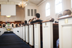 Students Listening in Estes Chapel - Aisle Shot
