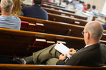 A Student Taking Notes in Estes Chapel