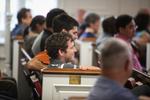 Students Listening in Estes Chapel - Side Shot