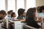 An International Student Listening in Estes Chapel
