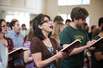 A Female Student Singing in Estes Chapel