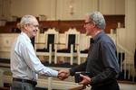 Dr. Steve O'Malley Shaking Hands with Dr. Steve Elliott