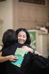International Students Hugging in Estes Chapel