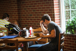 Miles Meehan Studying in the Dining Hall