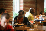 A Female Student Eating in the Dining Hall by Asbury Theological Seminary Communications