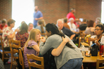 Students Hugging in the Dining Hall