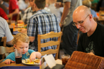 A Father and Son Eating in the Dining Hall