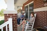 Jonas and Jessica Hamilton on Their Porch - 2