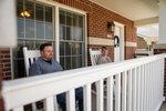 Jonas and Jessica Hamilton on Their Porch - 4