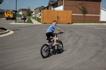 A Boy Riding a Bike in Kalas Village - 2