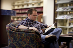 A Male Student Reading in the Orlando Library