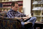 A Male Student Reading in the Orlando Library - 2