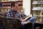 A Male Student Reading in the Orlando Library - 3