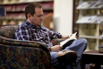 A Male Student Reading in the Orlando Library - 4