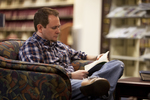 A Male Student Reading in the Orlando Library - 6