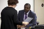Dr. Joseph Okello Talking with a Student